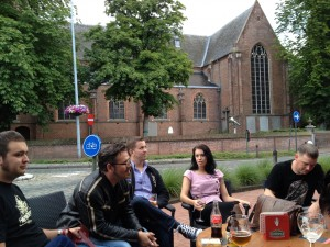 People sitting around a table drinking beer